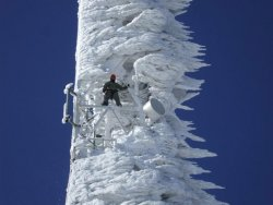 cell-phone-telecommunications-tower-covered-in-wind-blown-ice.jpg