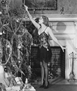 Lighting candles on a Christmas tree
